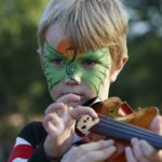 Tune Up Party child with face paint and violin